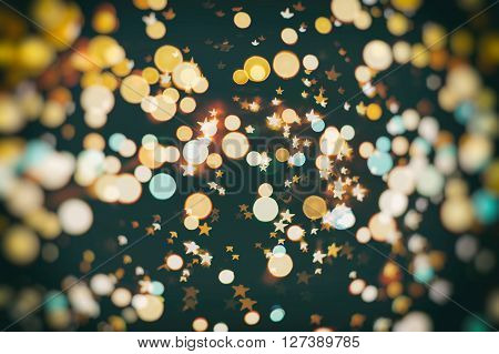 Festive elegant abstract background with bokeh lights and stars Texture, blue and gold.