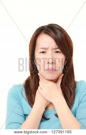 Japanese woman having throat pain on white background