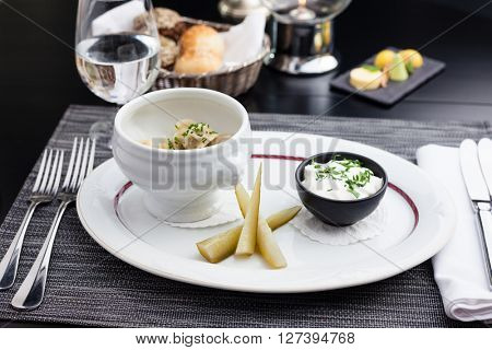Siberian dumplings with sour cream and horseradish mousse and pickles