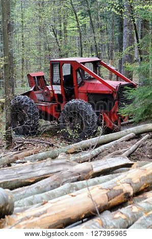 Cable skidder - heavy vehicle used in a logging operations for pulling cut trees out of a forest.