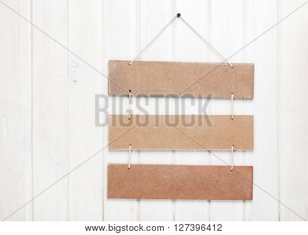 Signboard on white wooden wall