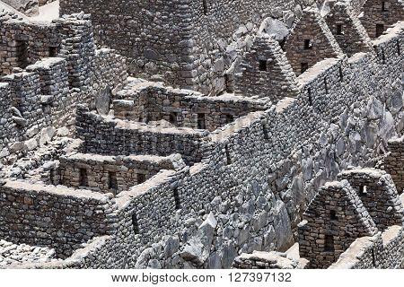 ruin walls and houses to Machu Picchu