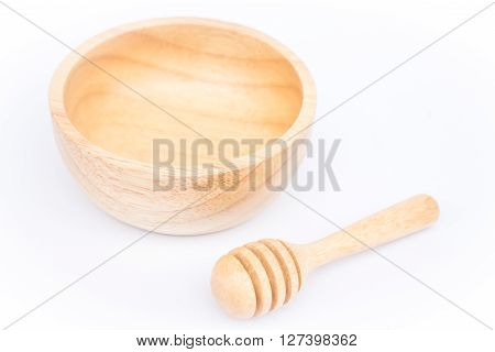 Wooden bowl and dipper on white background stock photo