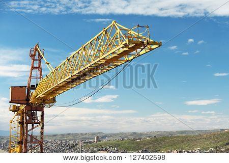 Construction crane tower against a blue sky