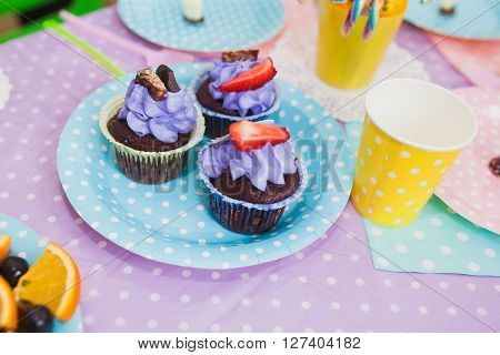 Cupcakes with the image of Alice in Wonderland. Children party