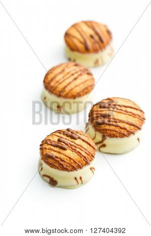 Sweet dessert. Biscuits with chocolate icing isolated on white background.