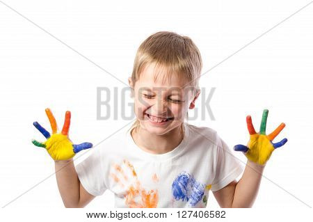 Funny boy with hands painted in colorful paint isolated on white background