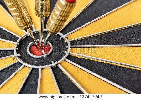 Closeup three dart target on bullseye Goal target success business investment financial strategy concept abstract background