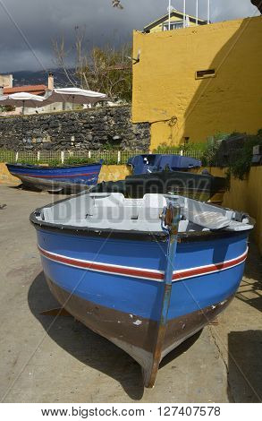 Small fishing boats on the seafront at Funchal in Madeira Portugal