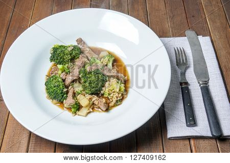 Healthy Beef and Broccoli stir fry served on a white plate