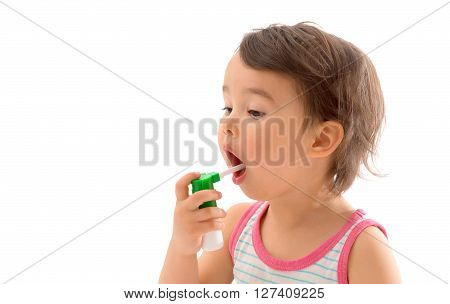 Little sick girl used medical spray for breath
