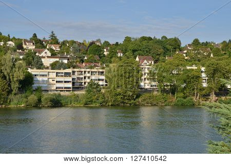 Triel sur Seine France - august 9 2015 : the picturesque city view from the left side of Seine river in summer