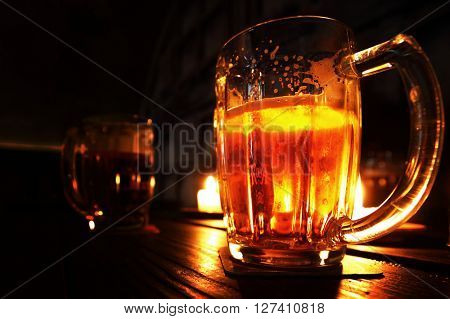 Two mugs of beer on table in bar