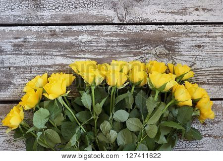Yellow Roses On A Wooden Background, Top View