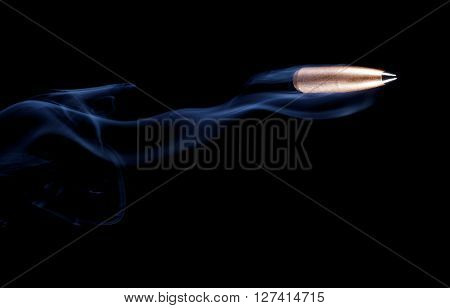 Bullet with copper plating and a polymer tip that looks like it is flying with smoke behind