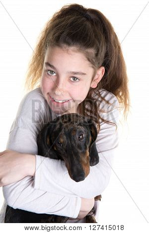 Portrait Of Beautiful Young Girl Snuggling With Cute Dog