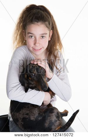 Happy Young Girl Cuddling Dog, Isolated On White In Studio