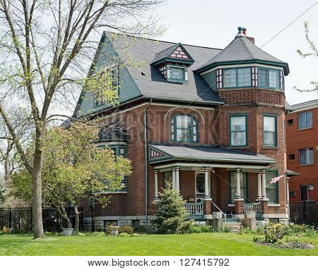 Brick Victorian House in Springtime