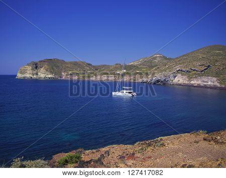 Catamaran Boat Parked In Calm Bay In Santorini