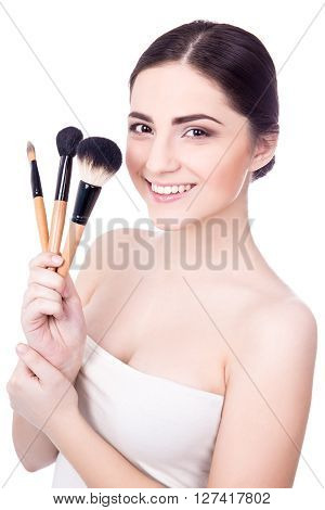 Portrait Of Young Beautiful Woman With Make Up Brushes Isolated On White