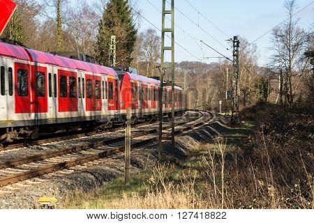ESSEN KETTWIG NRW GERMANY - FEBRUAR 12 2016: Level crossing in Essen Kettwig an der Ruhr on Kattenturm. In driving railway train toward Duesseldorf.