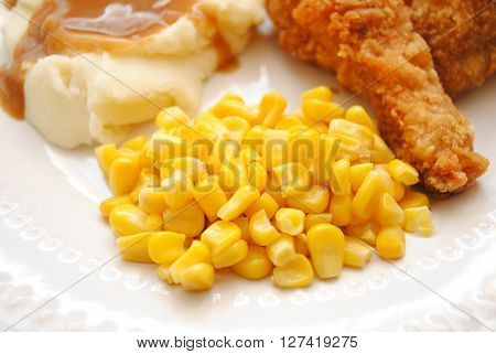 Corn Served as a Side Dish with Fried Chicken & Mashed Potatoes