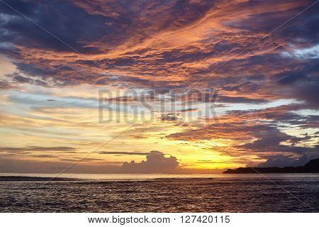 Beautiful bright sunset over the sea . Clouds , sea, sky .