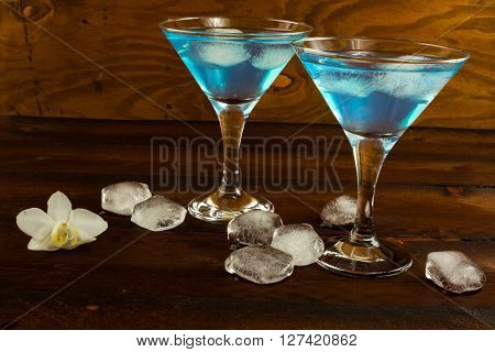 Blue curacao liqueur in a martini glasses. Blue cocktail. Blue margarita. Blue Hawaiian cocktail. Blue curacao liqueur. Blue Martini
