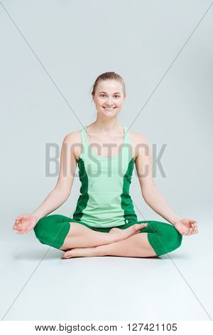 Happy woman meditating isolated on a white background