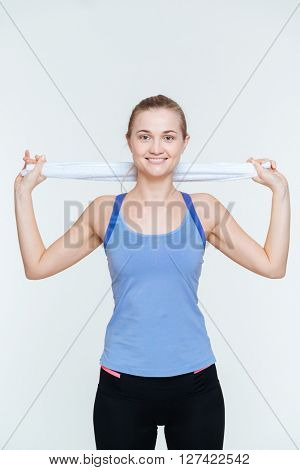 Happy fitness woman holding towel isolated on a white background