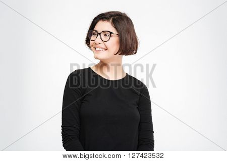 Cheerful young woman looking away isolated on a white background