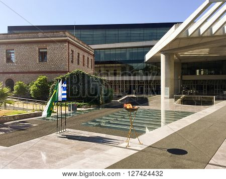ATHENS GREECE - APRIL 27 2016: The Olympic flame on its way to the Rio de Janeiro Summer Olympics makes a brief stop in front of the New Acropolis Museum.