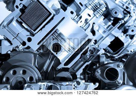 Cut section showing details of automotive engine