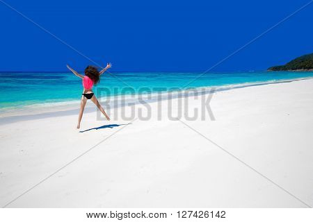 Enjoying Life. Happy Woman Jumping On Exotic Sea. Fit Brunette Girl Running Over Blue Sky On Tropica