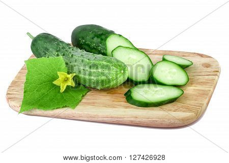 Organic cucumbers on a cutting board isolated on white