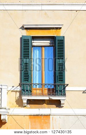 Typical old wndow with shutters in Venice, Italy