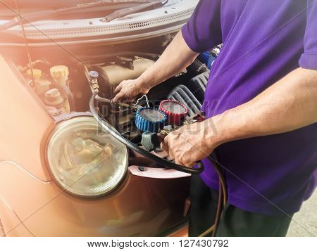 Man Recharge Refrigerant To System Of Car