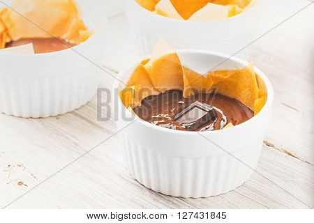 Chocolate mass for fondant in the ramekin horizontal