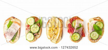 Different tartines on the white background wide screen