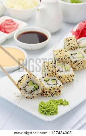 Japanese Cuisine. Shrimp Sushi Roll Ith Sauces Ginger And Wasabi On A Hite Plate.