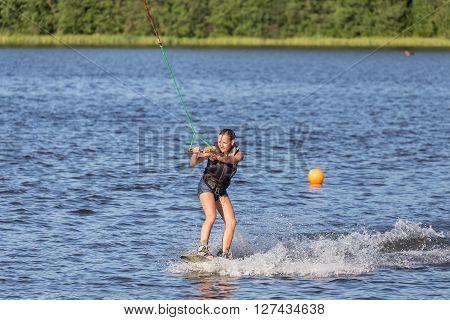 Woman Riding Wake Board