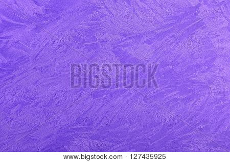 Glittery textured violet metallic paper background, close up