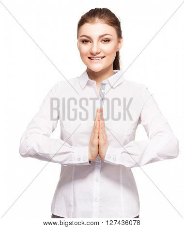Pleading young woman. Woman with folded hands isolated on white