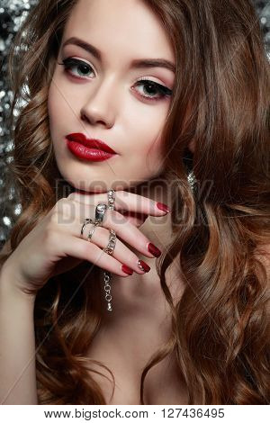 Fashion girl portrait  on a silvery background.Accessorys. Long curly hairs
