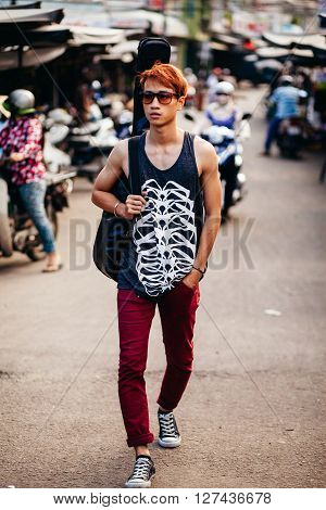 Asian Artist Man With Guitar  At Local Market In Nha Trang