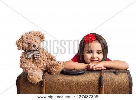 Beautiful little Girl smiling with suitcase and toy bear