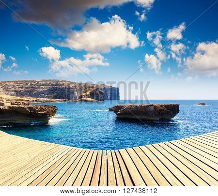Fantastic views of rocky coast. Picturesque and gorgeous scene. Clear sky on a sunny day with fluffy clouds. Location place Azure Window, Gozo island, Dwejra. Malta. Europe. Beauty world.