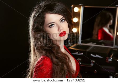 Makeup. Hairstyle. Beautiful Girl With Long Wavy Hair. Brunette Fashion Model With Red Lips In Sensu