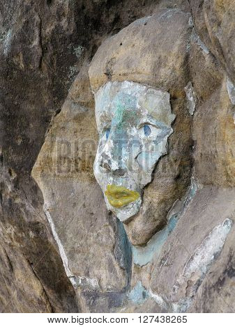 Rock relief - the face of the Sphinx - carved into the sandstone cliff