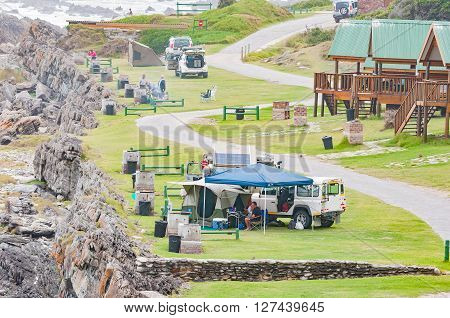 STORMS RIVER MOUTH SOUTH AFRICA - MARCH 1 2016: Unidentified tourists at camping sites next to chalets at Storms River Mouth